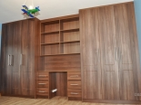 dark-walnut-cabinet-with-a-desk-in-the-middle